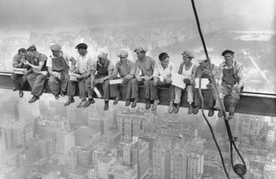 20 Sep 1932, Manhattan, New York City, New York State, USA --- While New York's thousands rush to crowded restaurants and congested lunch counters for their noon day lunch, these intrepid steel workers atop the 70 story RCA building in Rockefeller Center get all the air and freedom they want by lunching on a steel beam with a sheer drop of over 800 feet to the street level. The RCA building is the largest office building in terms of office space in the world. (original caption). Image taken 9/20/32; filed 9/29/32. --- Image by © Bettmann/CORBIS