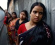 Jyotsna, 29, leads a line of sex workers, awaiting lunch customers in an alleyway of Sonagachi.