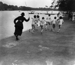 A British policewoman chasing after a group of naked street boys by the Serpentine in Hyde Park, London.   (Photo by Reg Speller/Getty Images)
