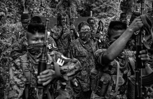 February 17, 2014. Members of the ELN (Ejercito de Liberación Nacional) take formation at their camp. A quater to half of recruited chilld combants are girls. Chocó, Colombia.