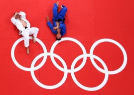 LONDON, ENGLAND - JULY 29:  Pawel Zagrodnik of Poland (white) and Masashi Ebinuma of Japan lay on the mat after their match in the Men's -66 kg Judo on Day two of the London 2012 Olympic Games at ExCeL on July 29, 2012 in London, England.  (Photo by Ian Walton/Getty Images)
