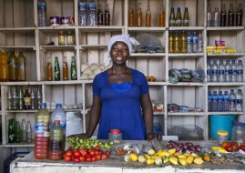 "ACCRA, GHANA: In addition to operating a roadside restaurant where she prepares local foods, Sandra Ocran is the financial secretary for the Initiative Development Ghana, a local NGO partnering with the Ga East Trade Union to provide microloans to GETU members. Over the past five years, Betty has been involved in supporting 40 members to access microloans to build their businesses. ""They are traders, some are bakerers, caterers, fish and tomato sellers, kenkey sellers and chopbars,"" she says, describing the types of vendors who are participating in the programme. ""Everybody has been paying back their loans,"" she says. Not one person has defaulted so far. ""We pay on a weekly basis. We come to the weekly meeting, and everybody must bring his or her money. Let's say you take [a loan in the amount of] 1,000 Ghana Cedis (approximately USD $262), every week you will repay 57 Ghana Cedis (about USD $15) for six months."" With these small loans, vendors have been able to build capital and expand their businesses. Photo taken August 12, 2015 in Accra, Ghana. (Photo by Jonathan Torgovnik/Getty Images Reportage). FULLY RELEASED - CONSENT NUMBER: ACC023"