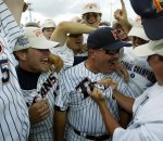 27 JUNE 2004:  Cal State Fullerton Head Coach celebrates with his team after defeating Texas during the Division I Men's Baseball Championship held at Rosenblatt Stadium in Omaha, NE.  Cal State Fullerton defeated Texas 3-2 for the national title.  Jamie Schwaberow/NCAA Photos via Getty Images