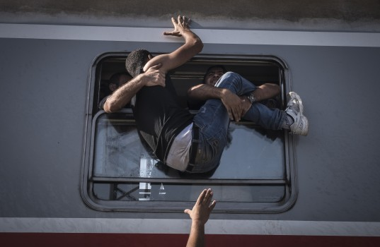 Refugees board the train towards Zagreb at Tovarnik station on the border with Serbia, Croatia, Friday September, 18, 2015.