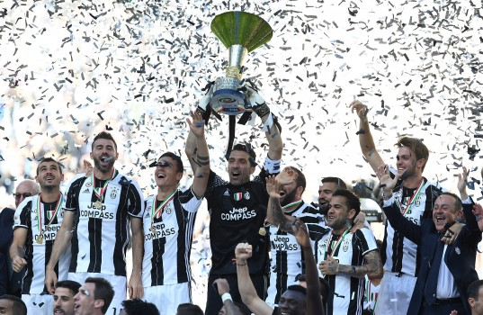 TURIN, ITALY - MAY 21:  Gianluigi Buffon of Juventus FC celebrates with the trophy after the beating FC Crotone 3-0 to win the Serie A Championships at the end of the Serie A match between Juventus FC and FC Crotone at Juventus Stadium on May 21, 2017 in Turin, Italy.  (Photo by Valerio Pennicino/Getty Images)