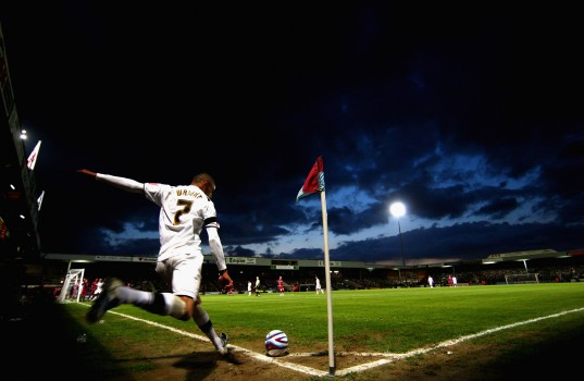 SCUNTHORPE, ENGLAND - MAY 08:  Mark Wright of the MK Dons takes a corner during the Coca-Cola Football League One play off semi-final, first leg match between Scunthorpe United and MK Dons at Glenford Park on May 8, 2009 in Scunthorpe, England.  (Photo by Jamie McDonald/Getty Images)