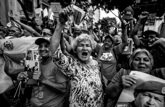 NOVEMBER 19, 2013: A group of woman shouts slogans against VenezuelaÕs opposition during a political rally in front the national Parliament. (Photo by Alejandro Cegarra)