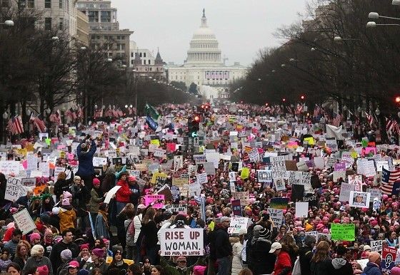 WASHINGTON, DC - JANUARY 21:  Protesters walk during the WomenÕs March on Washington, with the U.S. Capitol in the background, on January 21, 2017 in Washington, DC. Large crowds are attending the anti-Trump rally a day after U.S. President Donald Trump was sworn in as the 45th U.S. president.  (Photo by Mario Tama/Getty Images)